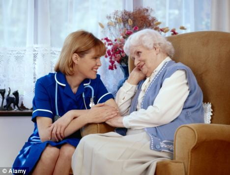 care home worker comforting a covid19 patient